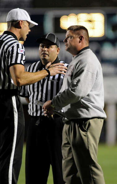 Westfield Head Coach Corby Meekins, right, challenges the referee's call during the Mustang's game a