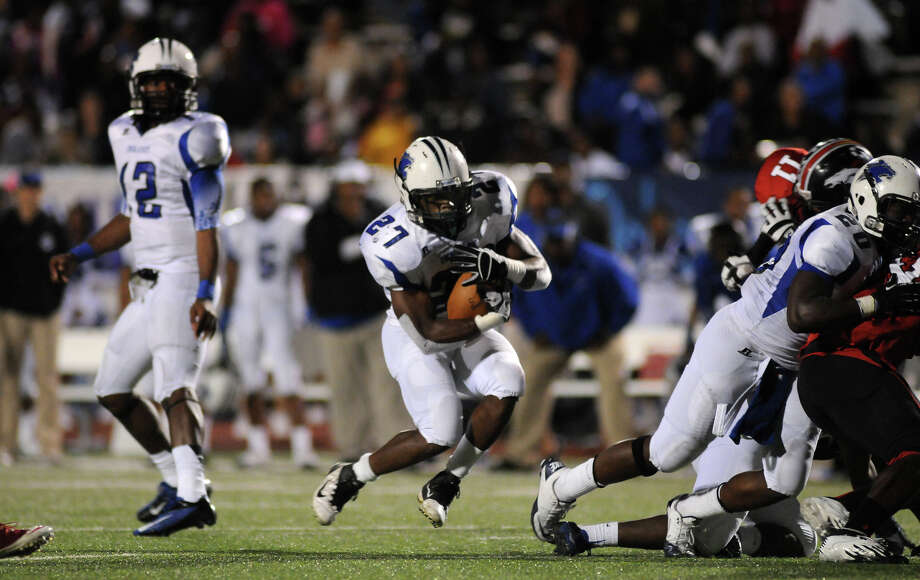 Dekaney junior running back Demarcus Felton (#27) runs behind the block of teammate Ja'Colby Pierre, right, during their game against Westfield at Leonard George Stadium on Thursday. Photo by Jerry Baker Photo: Jerry Baker, For The Chronicle