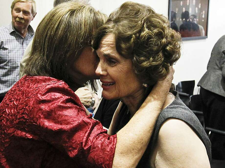 Sallie Badger, right, gets a hug from nurse Nancy Bowman, who treated several of the shooting victims on the scene of the Tucson mass shooting, after a news conference after the sentencing of Jared Loughner, at U.S. District Court Thursday, Nov. 8, 2012, in Tucson, Ariz. Loughner who pleaded guilty to a deadly Arizona shooting rampage that also wounded then-Congresswoman Gabrielle Giffords came face to face with his victims Thursday, with one scolding him and saying his parents and community had failed him. Photo: Ross D. Franklin, Associated Press