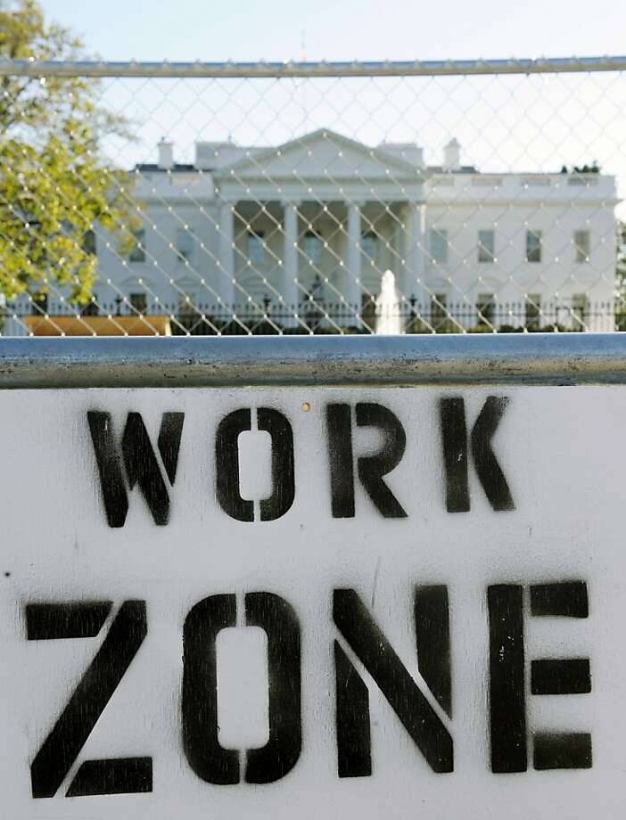 A sign on the security fence surrounding the construction area where workers are building the Presidential Inauguration reviewing stand in front of the White House in Washington, Thursday, Nov. 8, 2012. Photo: Cliff Owen, Associated Press
