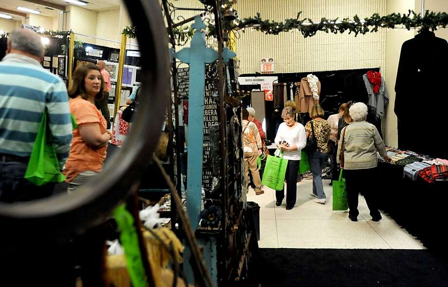 Shoppers look at different store booths at Mistletoe & Magic, the Junior League's three day shopping extravaganza Thursday, Nov. 8, 2012 in Tyler, Texas. The event is held November 7 – 10th at Harvey Convention Center. Photo: Sarah A Miller, Associated Press