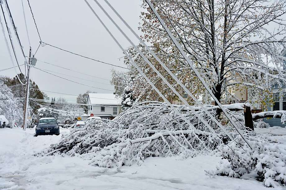 Downed lines on Crosby Avenue in Albertson, New York, on Thursday, November 8, 2012. A Wednesday storm brought ice and snow, which only made the existing damage from Superstorm Sandy worse. Photo: Audrey C. Tiernan, McClatchy-Tribune News Service
