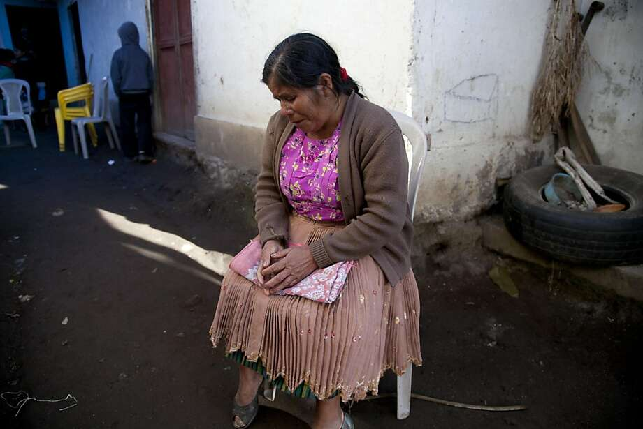 Zoila Gomez grieves outside the room where the wake is taking place for members of the Vasquez family who were buried alive when their house collapsed in San Cristobal Cucho, Guatemala, Thursday, Nov. 8, 2012. The family died when a magnitude 7.4 earthquake struck on Wednesday, collapsing the home of the Vasquez family and burying 10 of them, including a 4-year-old child, in the rubble. The quake killed at least 52 people and left dozens more missing. (AP Photo/Moises Castillo) Photo: Moises Castillo, Associated Press