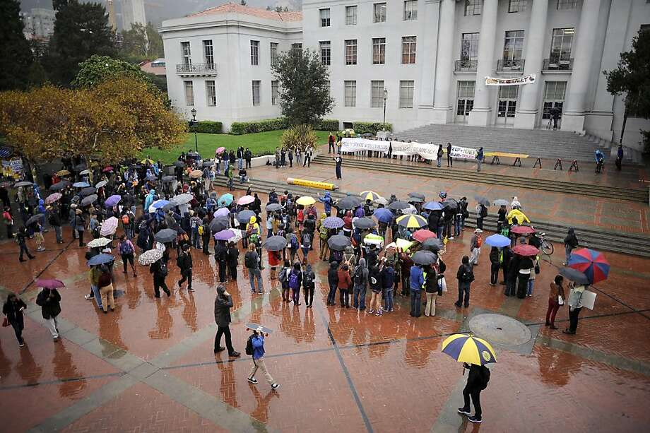 Students brave the pouring rain to gather in front of Sproul Hall.  Berkeley and other UC campuses staged a walkout to push for using Prop 30 and other funds to immediately roll back tuition and cuts, on the Cal campus in Berkeley, CA, November 8th, 2012. Photo: Michael Short, Special To The Chronicle