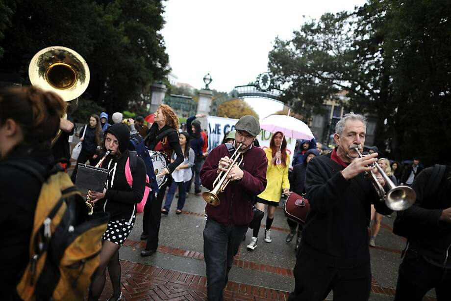 Members of the Brass Liberation Orchestra march with students and faculty towards Wheeler Hall.  Berkeley and other UC campuses staged a walkout to push for using Prop 30 and other funds to immediately roll back tuition and cuts, on the Cal campus in Berkeley, CA, November 8th, 2012. Photo: Michael Short, Special To The Chronicle