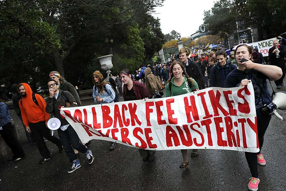 Students and faculty march from Sproul Plaza to Wheeler Hall in order to get out of the rain.  Berkeley and other UC campuses staged a walkout to push for using Prop 30 and other funds to immediately roll back tuition and cuts, on the Cal campus in Berkeley, CA, November 8th, 2012. Photo: Michael Short, Special To The Chronicle