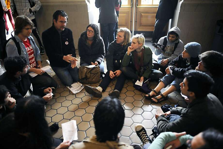 Protesters gather in Wheeler Hall to get out of the rain and discuss what their demands of the UC Regents should entail.  Berkeley and other UC campuses staged a walkout to push for using Prop 30 and other funds to immediately roll back tuition and cuts, on the Cal campus in Berkeley, CA, November 8th, 2012. Photo: Michael Short, Special To The Chronicle