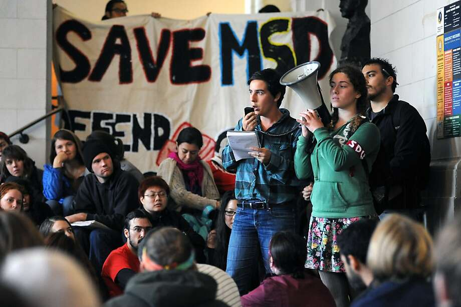 Students and faculty listen to speakers as they gather in Wheeler Hall after moving from Sproul Plaza.  Berkeley and other UC campuses staged a walkout to push for using Prop 30 and other funds to immediately roll back tuition and cuts, on the Cal campus in Berkeley, CA, November 8th, 2012. Photo: Michael Short, Special To The Chronicle