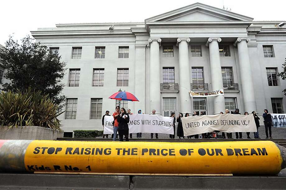 Students and faculty brave the pouring rain to gather and listen to speakers in front of Sproul Hall.  Berkeley and other UC campuses staged a walkout to push for using Prop 30 and other funds to immediately roll back tuition and cuts, on the Cal campus in Berkeley, CA, November 8th, 2012. Photo: Michael Short, Special To The Chronicle