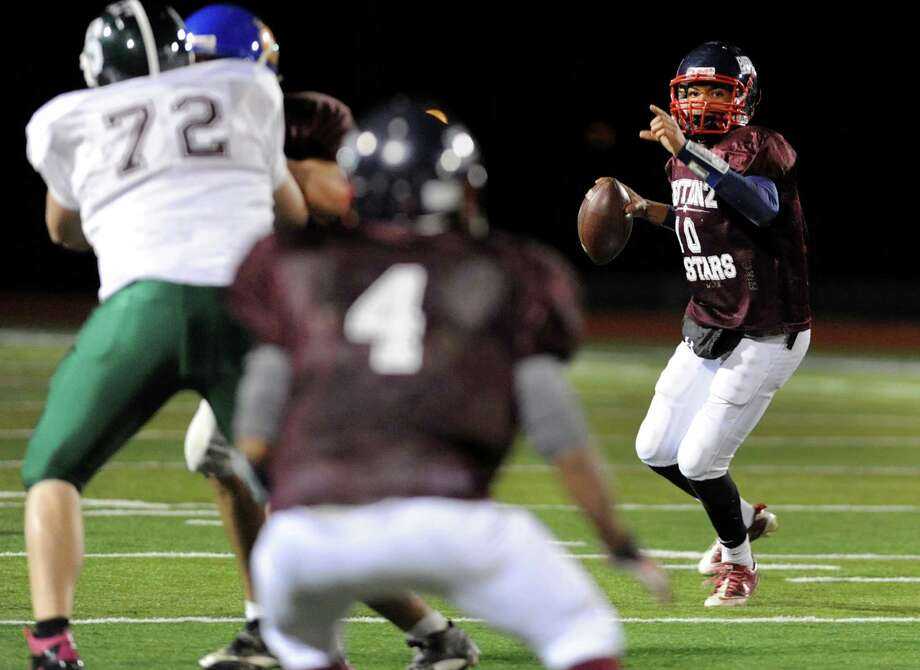 Schenectady's Kwame Jarvis (10), right, looks to pass during the Section II Exceptional Senior Football game on Thursday, Nov. 8, 2012, at Shenendehowa High in Clifton Park, N.Y. (Cindy Schultz / Times Union) Photo: Cindy Schultz / 00020022A