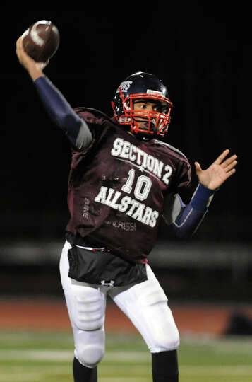 Schenectady's Kwame Jarvis (10) passes the ball during the Section II Exceptional Senior Football ga