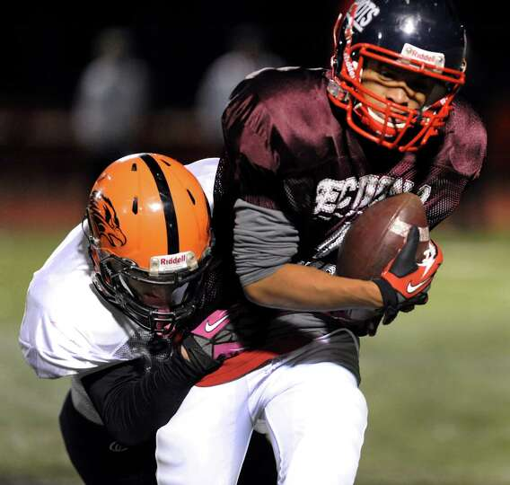 Schenectady's Alex Phann (4) gains yards during the Section II Exceptional Senior Football game on T