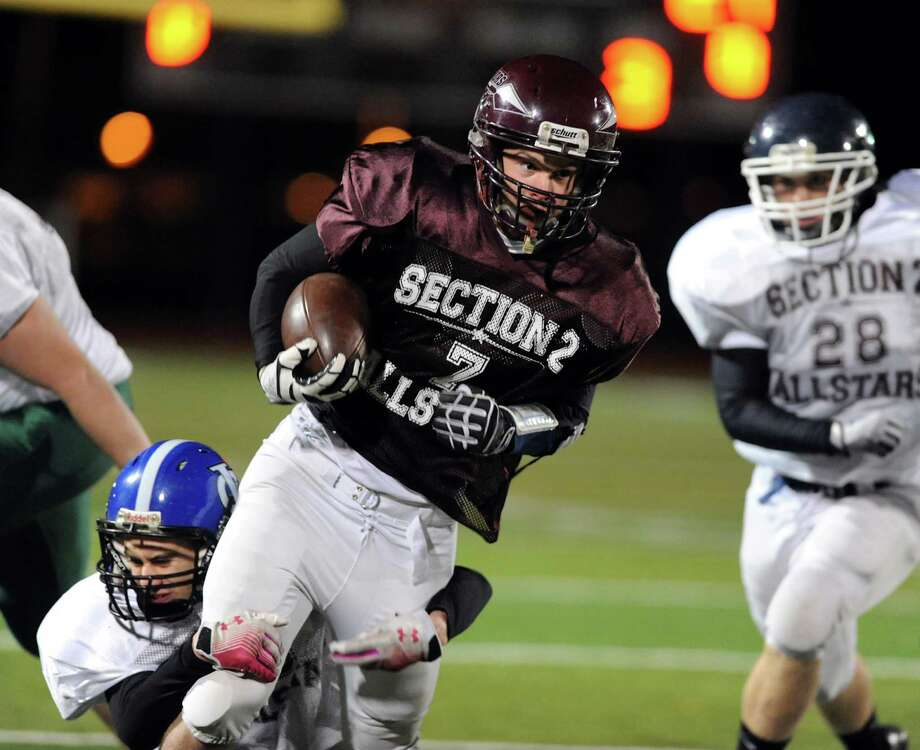 Stillwater's Shawn McNeil, center, (7) fights off a tackle from Ichabod Crane's Brian Pulsifer (3) during the Section II Exceptional Senior Football game on Thursday, Nov. 8, 2012, at Shenendehowa High in Clifton Park, N.Y. (Cindy Schultz / Times Union) Photo: Cindy Schultz / 00020022A