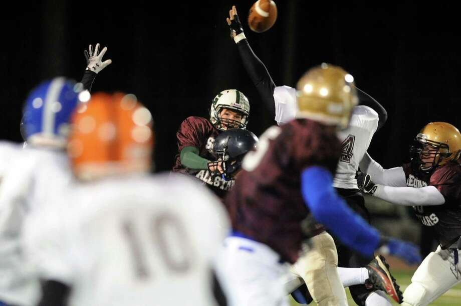 Greenwich's Jake Jennings (15), center, throws a pass during the Section II Exceptional Senior Football game on Thursday, Nov. 8, 2012, at Shenendehowa High in Clifton Park, N.Y. (Cindy Schultz / Times Union) Photo: Cindy Schultz / 00020022A