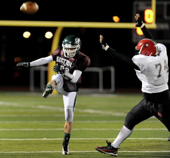 Shenendehowa's Corey Acker (22), center, punts the ball during the Section II Exceptional Senior Foo