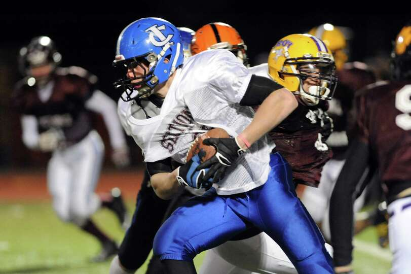Ichabod Crane's Shawn Gerkman (25), center, gains yards as during the Section II Exceptional Senior