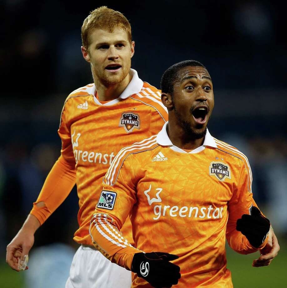 Andre Hainault, left, and Corey Ashe have taken their games to another level in the playoffs, something the Dynamo do regularly. Photo: Jamie Squire, Staff / 2012 Getty Images