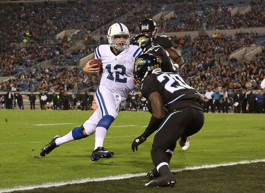 Indianapolis quarterback Andrew Luck (12) scampers for a 5-yard touchdown against Jacksonville in the first quarter - one of his two rushing touchdowns. Photo: Mike Ehrmann, Staff / 2012 Getty Images