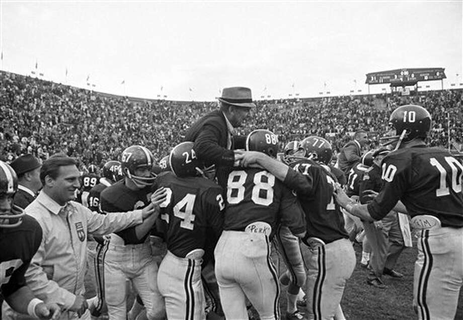 Alabama football players hoist Coach Paul (Bear) Bryant to their shoulders after the Crimson Tide finished an unbeaten, untied season with a 31-0 triumph over Auburn at Birmingham, Alabama, Dec. 5, 1966. Identifiable players are (from left) John Mosley, Ray Perkins, Jerry Duncan and Wayne Trimble. Photo: Charles Kelly, AP File Photo / AP1966