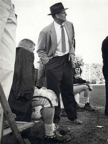 "In this Sept. 27, 1958 photo, Alabama coach Paul ""Bear"" Bryant looks on during a college football game against LSU at Ladd Stadium in Mobile, Ala. It was coachBryant's first game in charge of the Crimson Tide, and one that flashed promise for a rebuilding program. For visiting LSU, it was an early step toward an undefeated season and national title. Photo: Anonymous, AP File Photo / AP2008"