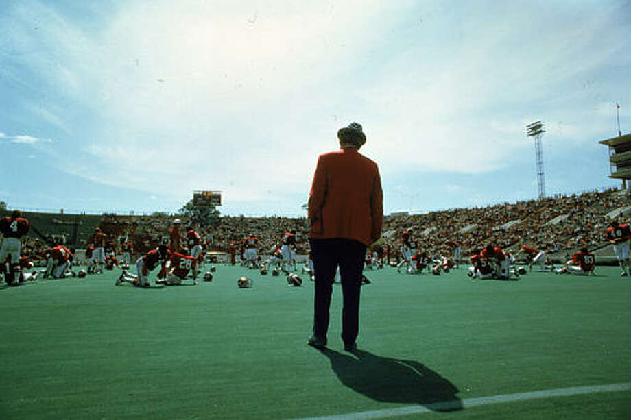 "University of Alabama football coach Paul ""Bear"" Bryant stands in the end zone and surveys his team warm up for a home game at Tuscaloosa, Ala., in 1979.  Bryant, 66, who had 284 wins at the start of this season, has signed a new five-year contract at Alabama. Photo: JOE HOLLOWAY JR., AP File Photo / AP1979"
