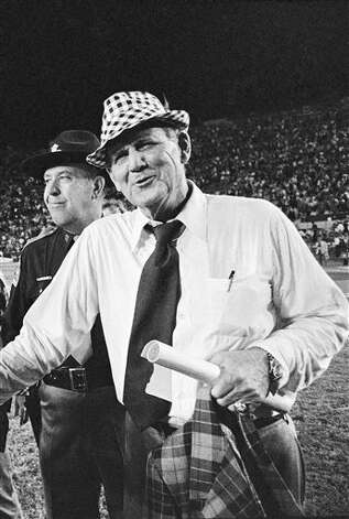 Second ranked Alabama head coach Bear Bryant (right) has a grin and a handshake for Louisiana State coach Charles McClendon after his Crimson Tide knocked off seventh ranked Tigers 21-7 in Baton Rouge on Nov. 22, 1973. Photo: AP File Photo
