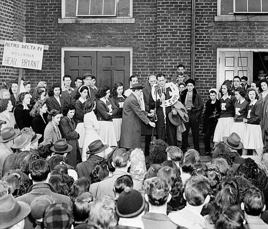 "Students at the University of Kentucky welcome Paul ""Bear"" Bryant, the new football coach, on his arrival at the campus in Lexington, Jan. 18, 1946.  Bryant, who came here from the University of Maryland, signed a five-year contract at an unannounced salary. Photo: AP File Photo / AP1946"