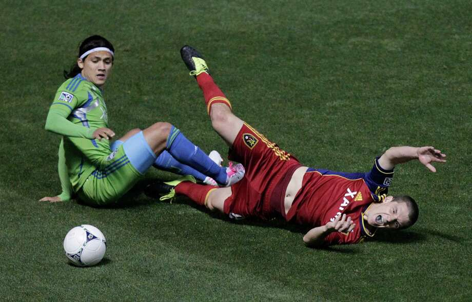 CORRECTS NAME OF REAL SALT LAKE PLAYER TO WILL JOHNSON - Seattle Sounders forward Fredy Montero (17) and Real Salt Lake midfielder Will Johnson, right, go after a ball in the first half during an MLS Western Conference semifinal soccer match Thursday, Nov. 8, 2012, in Sandy, Utah. Photo: AP