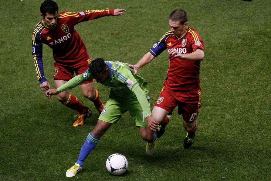 Real Salt Lake defender Tony Beltran (2) and Real Salt Lake midfielder Will Johnson (8) and Seattle