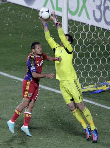 Seattle Sounders goalkeeper Michael Gspurning (1) makes a save as Real Salt Lake forward Paulo Junior moves in during the first half of an MLS Western Conference semifinal soccer match Thursday, Nov. 8, 2012, in Sandy, Utah. Photo: AP