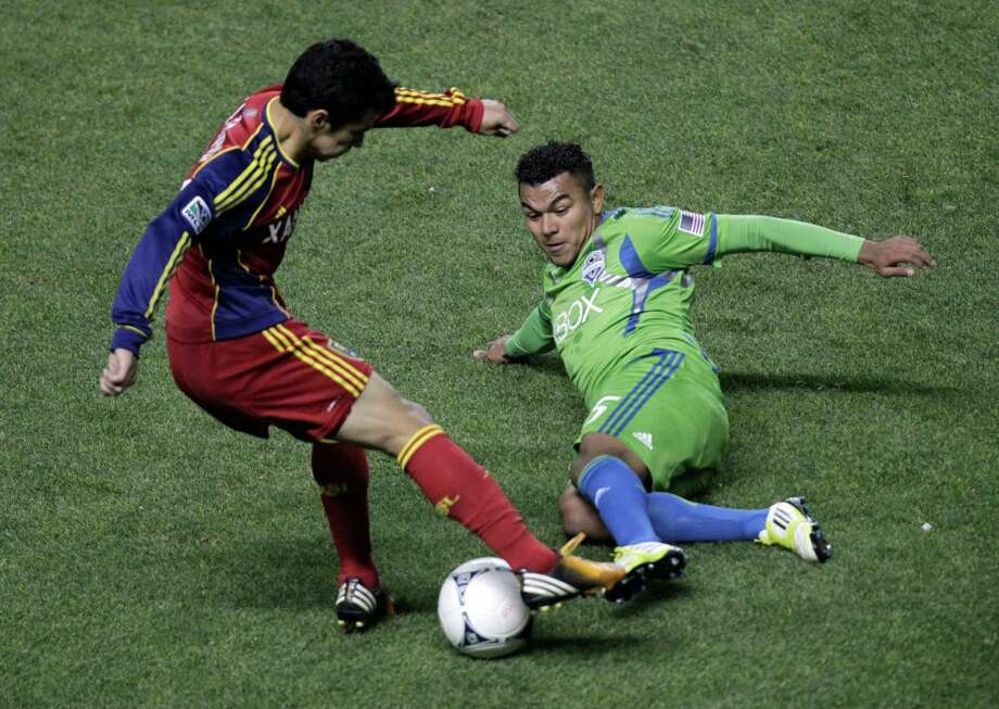 Seattle Sounders' Mario Martinez, right, and Real Salt Lake defender Tony Beltran, left, go after the ball in the first half during an MLS Western Conference semifinal soccer match Thursday, Nov. 8, 2012, in Sandy, Utah. Photo: AP