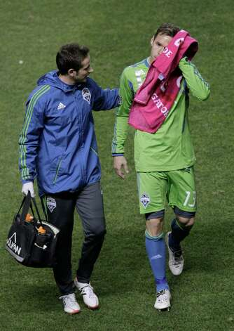 Seattle Sounders' Christian Tiffert (13) leaves the field with an injury during the first half of an MLS Western Conference semifinal soccer match against Real Salt Lake on Thursday, Nov. 8, 2012, in Sandy, Utah. Photo: AP