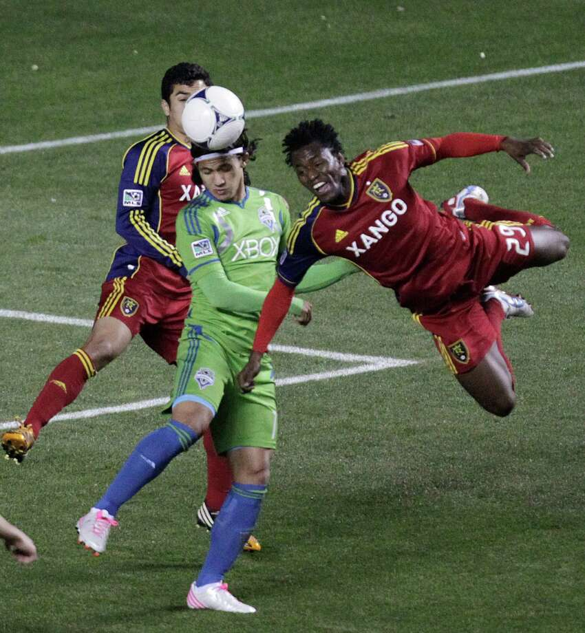 Real Salt Lake midfielder Kenny Mansally (29) heads the ball as Seattle Sounders forward Fredy Montero, center, watches during the first half of an MLS Western Conference semifinal soccer match Thursday, Nov. 8, 2012, in Sandy, Utah. Photo: AP