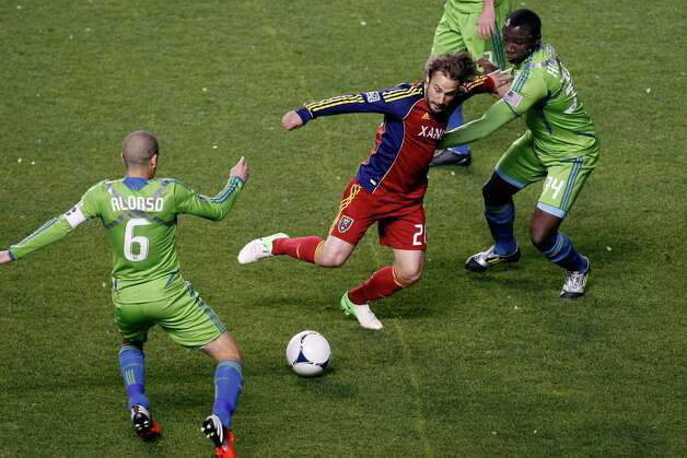 Real Salt Lake midfielder Ned Grabavoy (20) Seattle Sounders FC midfielder Osvaldo Alonso (6) and Seattle Sounders FC defender Jhon Kennedy Hurtado (34) during the first half of an MLS playoff game  at Rio Tinto Stadium in Sandy, Utah, Thursday Nov. 8, 2012. Photo: AP