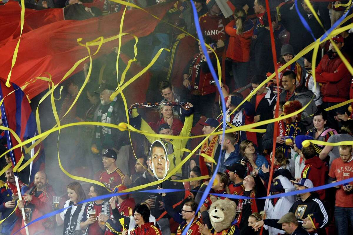 Real Salt Lake fans cheer during the first half of the MLS playoff game at Rio Tinto Stadium in Sandy, Utah, Thursday Nov. 8, 2012.