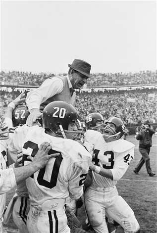 "In this Jan. 1, 1966 file photo, Alabama coach Paul ""Bear"" Bryant gets a ride on the shoulders of his team after Alabama beat Nebraska, 34-7 in the Sugar Bowl in New Orleans. Halfback Eddie Propst (43) rushes up to congratulate his coach as others join in the celebration. In the foreground is Donnie Johnson (20). Once again, the Crimson Tide has a program the Bear would be proud of: unbeaten and ranked No. 1. Photo: AP File Photo"