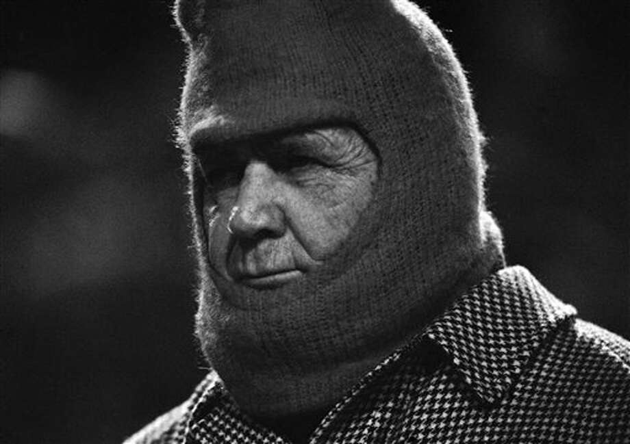 "Alabama football coach Paul ""Bear"" Bryant is usually seen wearing his checkered hat. But the cold weather in Memphis forced The Bear to wear more practical head gear as his Crimson Tide played U.C.L.A. in Monday, Dec. 20, 1976 in Memphis at the  Liberty Bowl. Photo: AP File Photo"