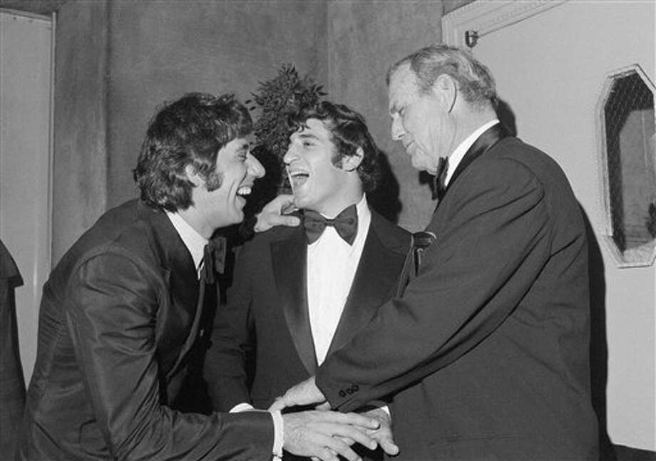 New York Jets quarterback Joe Namath, left, shares a laugh with Johnny Musso, University of Alabama, center, and Alabama Coach Paul �Bear� Bryant during annual awards dinner of the National Football Foundation in New York�s Waldorf-Astoria Hotel on Dec. 7, 1971. Namath is an Alabama alumnus. Photo: AP File Photo