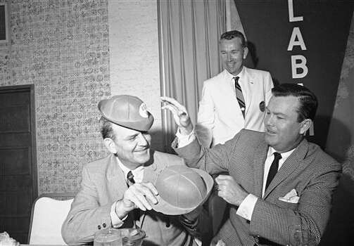 Rival coaches in the Jan. 1, 1965 Orange Bowl game, Paul (Bear) Bryant of Alabama, left, and Darrell Royal of Texas, swap hats during a fun session  Dec. 29, 1964 at the Annual Coaches Stag luncheon in Miami. Photo: AP File Photo / AP1964