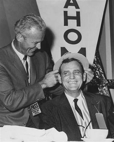 "Bud Wilkinson, left, Oklahoma football coach; places a paper hat on Alabama coach Paul ""Bear"" Bryant during some frivolous play at the annual Orange Bowl stage luncheon on Dec. 28, 1962 in Miami, Florida. Their teams play in the Orange Bowl New Years day. Photo: Anonymous, AP File Photo / 1962 AP"