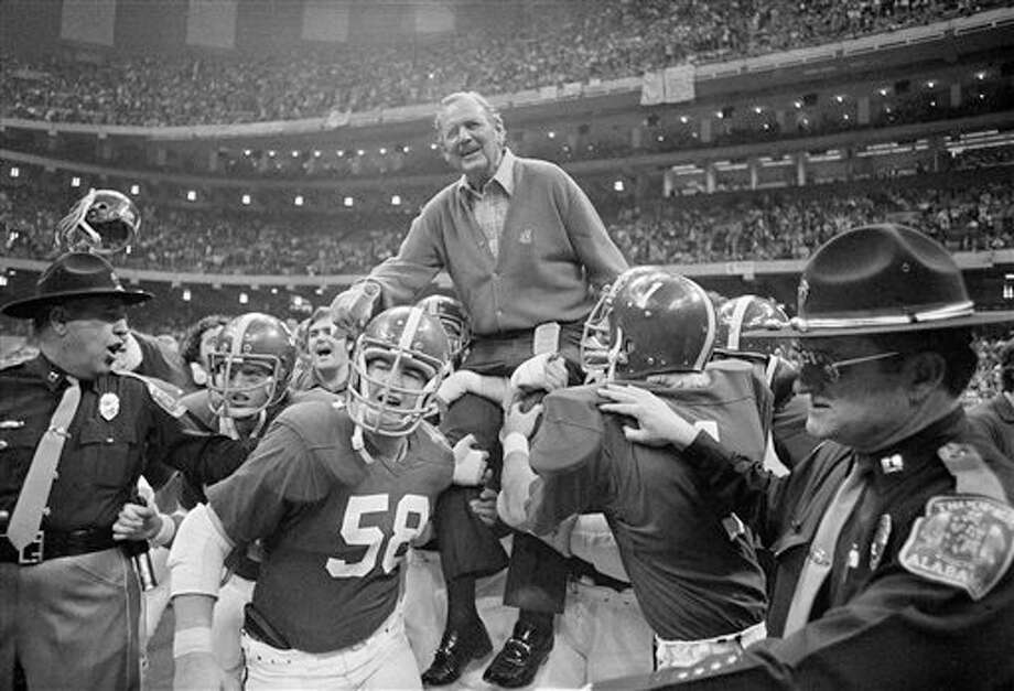 Coach Bear Bryant of Alabama is carried off the field Wednesday night after his team defeated Penn State 13-6 in the 42nd annual Sugar Bowl in New Orleans, Jan. 1, 1976. Photo: Anonymous, AP File Photo / AP1976