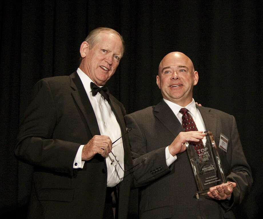 Sweeney with John Buzga, career specialist at David Weekley Homes, winner for midsize companies.