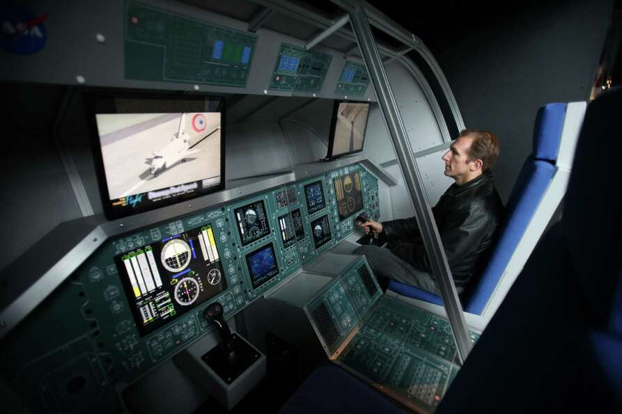 Matt Konvalin tries his hand at landing a space shuttle in a simulator, part of the Space Shuttle Fu