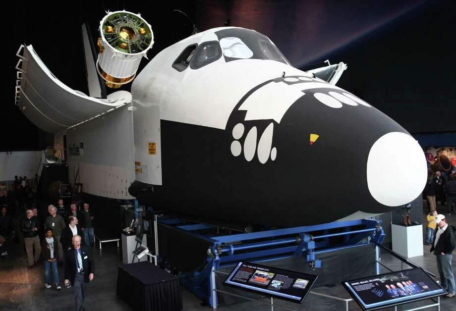 Visitors explore the Space Shuttle Full Fuselage Trainer on Thursday, November 8, 2012 in the Charles Simonyi Space Gallery at Seattle's Museum of Flight. The Museum will host a public grand opening event for the new exhibit on Saturday, November 10th. The fully-assembled shuttle trainer is four storeis tall and over 100 feet long and was used to train every space shuttle astronaut. Photo: JOSHUA TRUJILLO / SEATTLEPI.COM