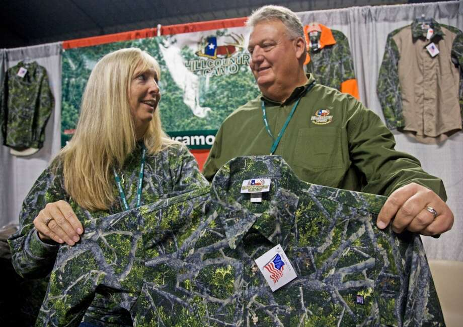Debbie and Todd St. Francis of Deer Park show off a Hill Country Camo shirt with the pattern that works well anywhere there is a lot of greens and grays.