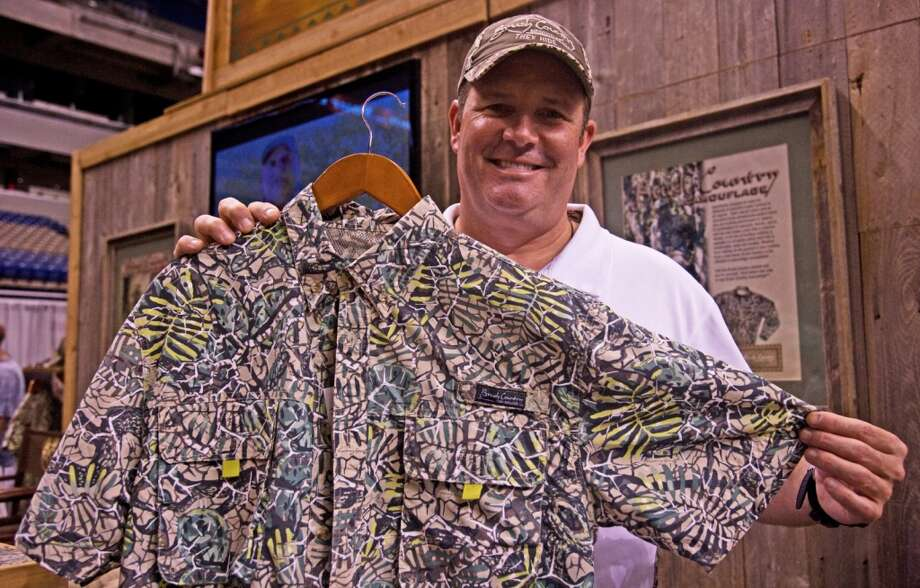 Justin Gayle of College Station displays a shirt from Brush Country Camouflage, which he designed as a better fit for what Texas hunters find in the wild.