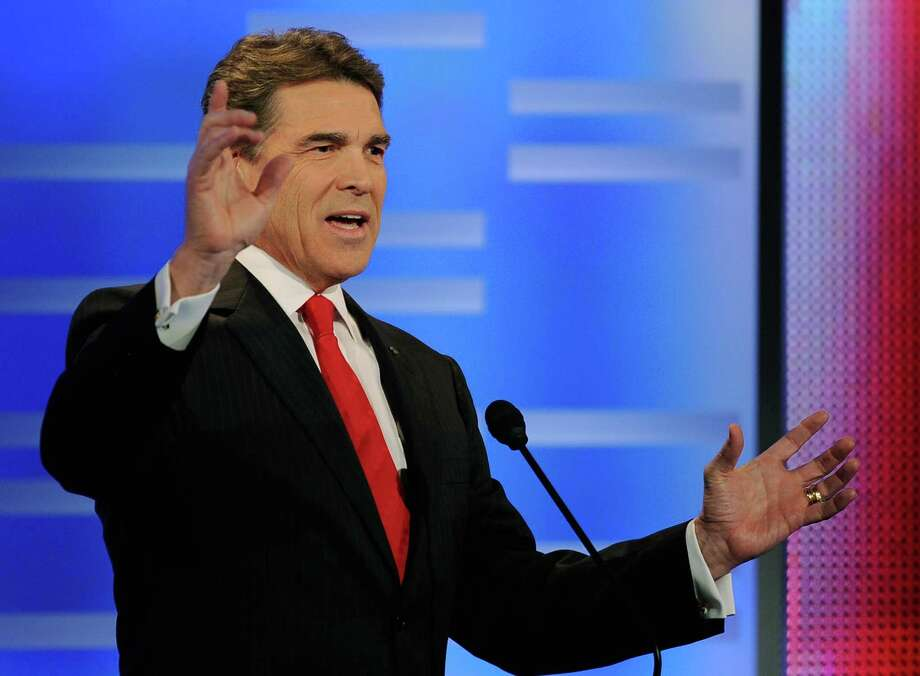 Texas Gov. Rick Perry speaks during the ABC News GOP Presidential debate on the campus of Drake University on December 10, 2011 in Des Moines, Iowa. Photo: Kevork Djansezian, Getty / 2011 Getty Images