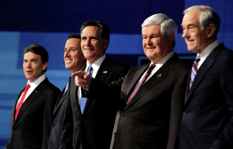 Rick Perry, Rick Santorum, Mitt Romney, Newt Gingrich and Ron Paul pose for a photo at the start of the South Carolina Republican presidential candidate debate Monday, Jan. 16, 2012, in Myrtle Beach, S.C. Photo: David Goldman, Associated Press / AP
