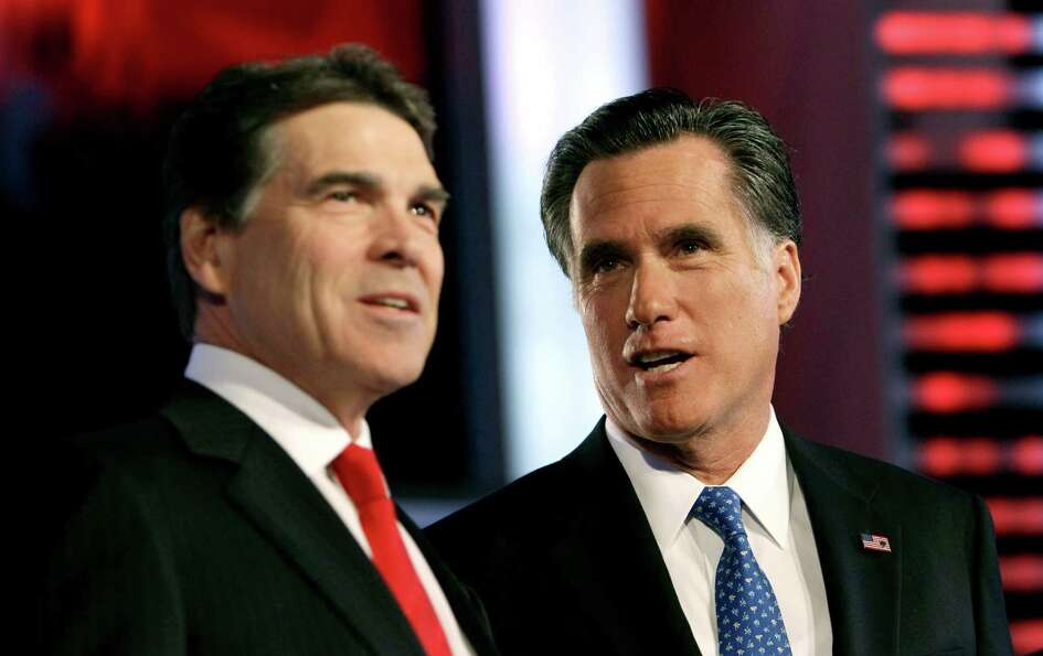 Rick Perry and Mitt Romney talk prior to the Republican debate, Saturday, Dec. 10, 2011, in Des Moin