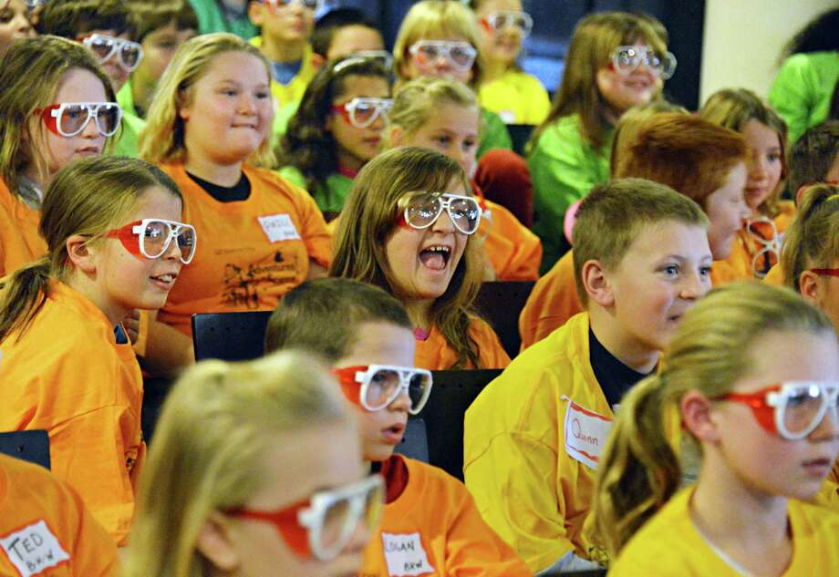 4th graders from the Middleburgh, Schoharie, Sharon Springs, Jefferson, and Berne-Knox-Westerlo schools watch a science show during Science Day at GE Global Research in Niskayuna Thursday Nov. 8, 2012.  (John Carl D'Annibale / Times Union) Photo: John Carl D'Annibale / 00020024A